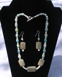 Designs by Adrienne created this African Opal necklace and earring set that is accented with Amazonite gemstones and freshwater potato shaped pearls.