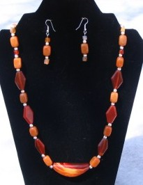 Adrienne has designed this brazilian banded agate with carnelian accent beads and bali siliver beads make a wonderful gift for any lady. It will be shown at the Riverton Rendezvous at the Park this summer on July 14 in Wyoming.